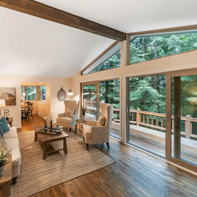 Dark brown hardwood flooring in Victoria home in the forest