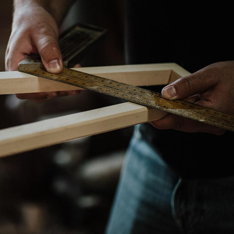 Hardwood Flooring in Victoria installation with hands measuring wood