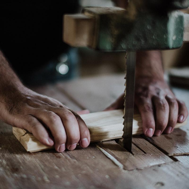 Saw cutting through hardwood flooring